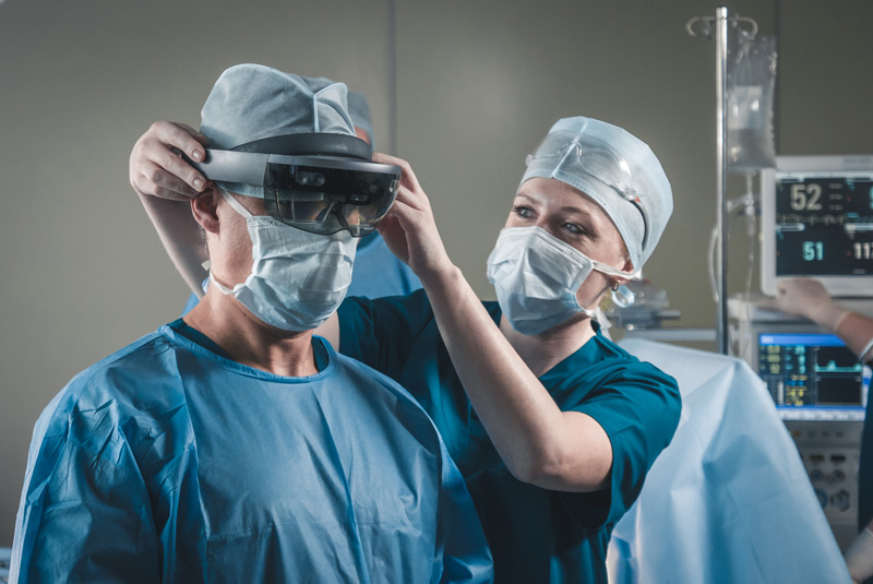 A surgeon wearing AR glasses